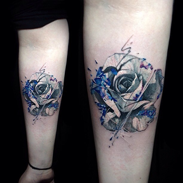 Graphic style rose tattoo on the left inner forearm Vlad Tokmenin