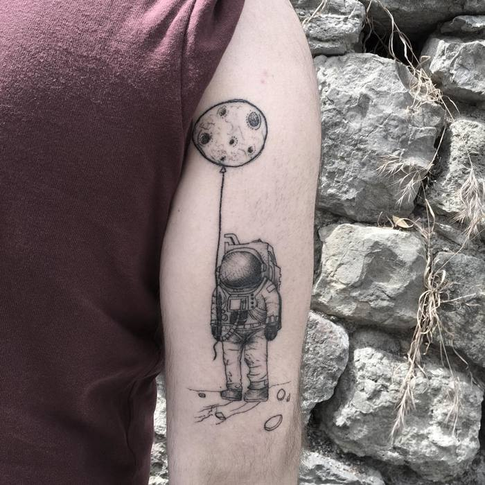 Astronaut Tattoo Holding the Moon by Resul Odabas