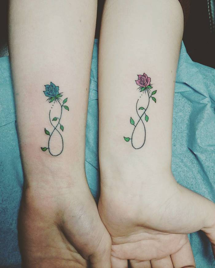 Matching Floral Tattoos by paul egan